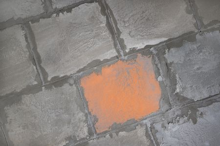 uncoated: Wall from concrete blocks. With orange block - hiding place.
