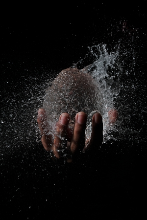 waterball in hand Stock Photo