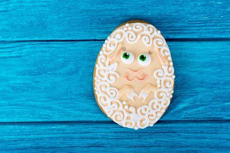 easter cookie: A little sheep. one Easter cookie on blue wooden background