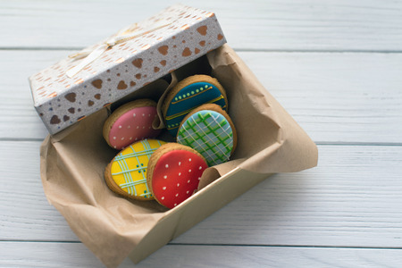 Easter cookies in a box on grey wooden background topview photo