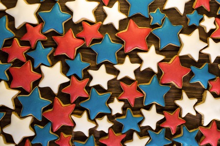 A lot of star shape ginger cookies on a wooden background