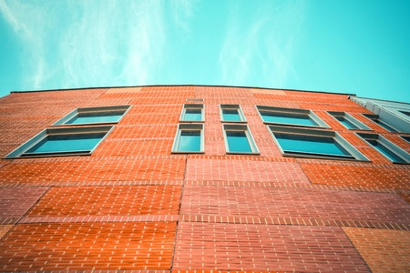 Part of a new office brick building with blue sky Stock Photo