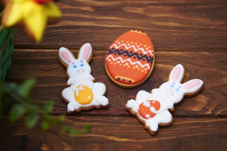 middle easter: Delicious Easter cookies background. Big Easter cookie, and rabbits in the middle on a rustic wooden background. Shallow depth of field