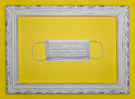 gray protective face mask with vintage photo frame on yellow background