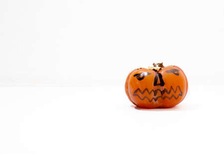Jack - o ' - lantern, Halloween monsters - muzzles drawn on persimmon fruit. Persimmon is very similar to a pumpkin, the same orange and cheerful.