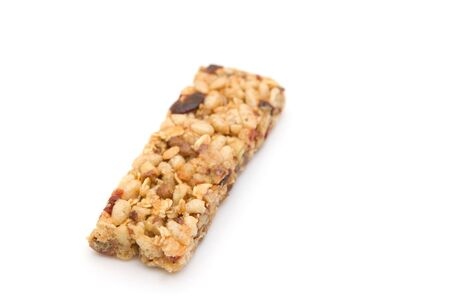 angle bar: One single healthy and delicious fruit and nut granola bar at an angle