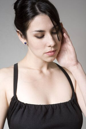 Stressed attractive woman in black with a headache photo