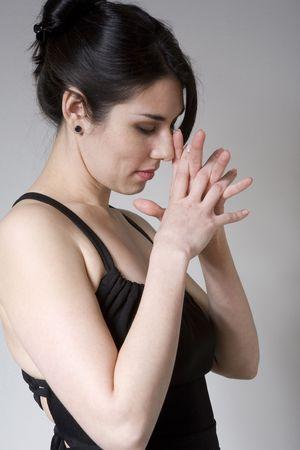hispanic woman contemplating or praying about something photo
