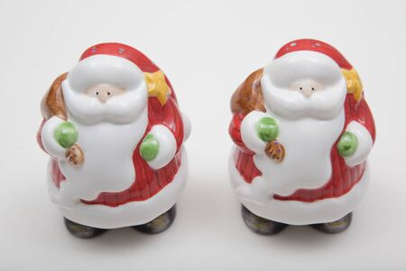 Santa Claus salt and pepper shakers isolated on white background photo