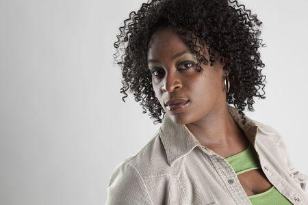 Headshot of beautiful and serious black woman Stock Photo