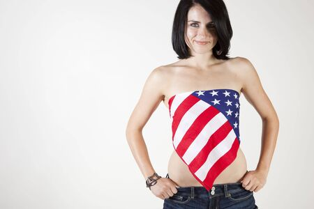 Sexy patriotic woman smiling and facing the camera. photo