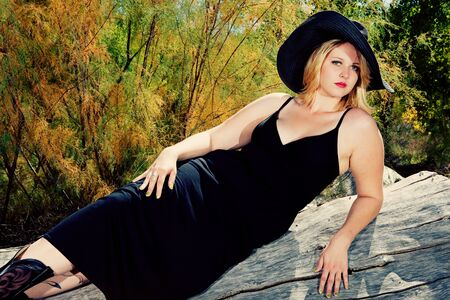 sundress: full figured blonde woman outdoors in sundress with black hat