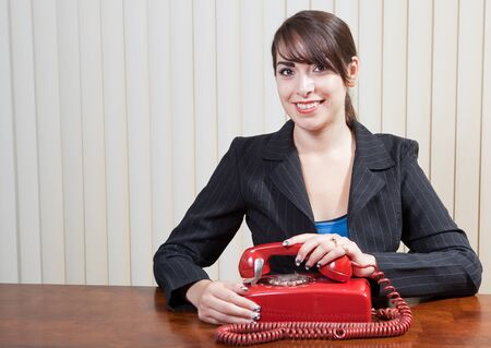 smiling young Hispanic woman with old rotary phone Stock Photo - 13547700