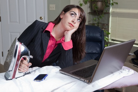 Woman struggling between work life balance Stock Photo - 13547775