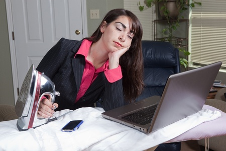 Woman struggling between work life balance photo