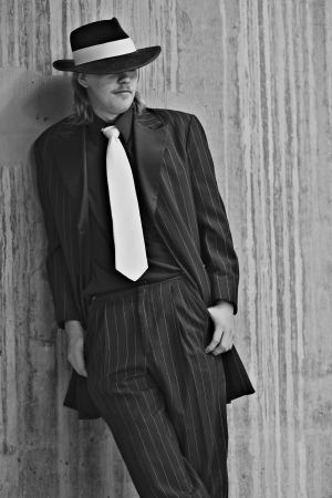 Dapper young man in urban setting wearing zoot suit photo