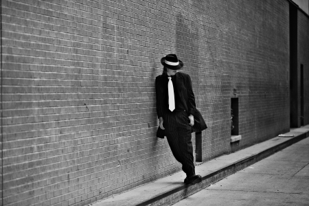 and the horizontal man: Dapper young man in urban setting wearing zoot suit