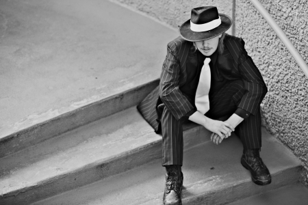 Dapper young man in urban setting wearing zoot suit