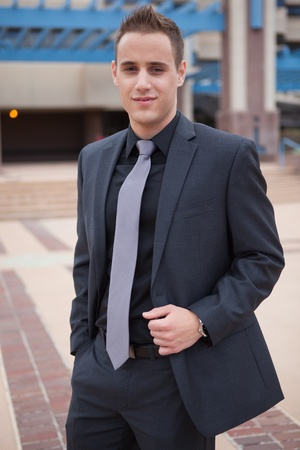 Young professional in a dark suit in the city  Stock Photo