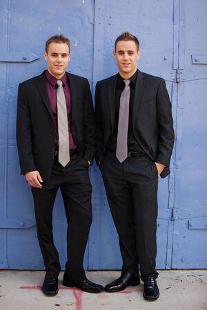 Handsome sharp dressed businessmen; identical twins  Stock Photo