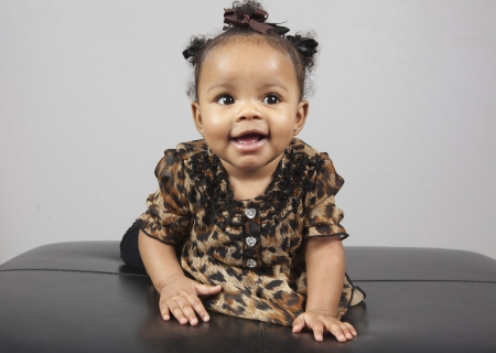 bright eyed: Portrait of beautiful 6 month old African American Baby Stock Photo