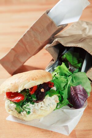 lettuces: Chicken Salad Sandwich garnished with leafy lettuces