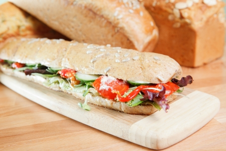 Chicken Salad Sandwich on wooden cutting board