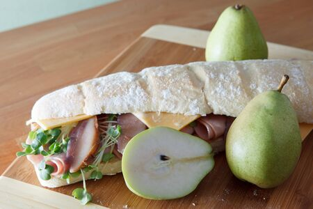 Ham and cheese sandwich on baugette with poached pear Stock Photo - 17239704