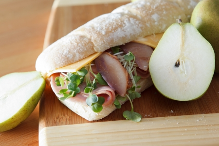 Ham and cheese sandwich on baugette with poached pear Stock Photo - 17239706