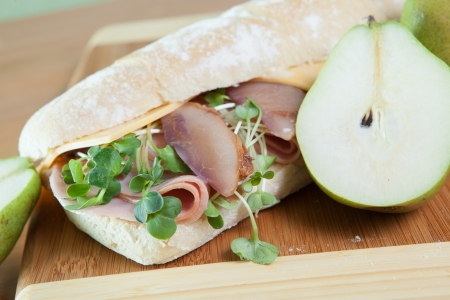 Ham and cheese sandwich on baugette with poached pear Stock Photo - 17239709