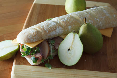 Ham and cheese sandwich on baugette with poached pear Stock Photo - 17239693