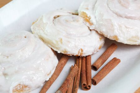 Fresh baked Cinnamon rolls with icing Stock Photo