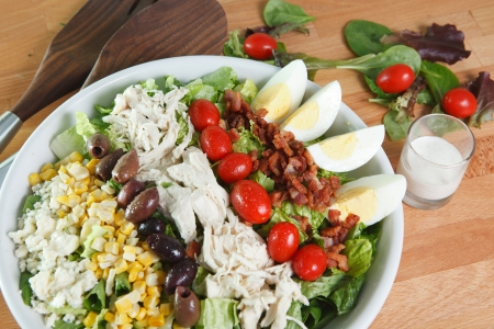 Fresh colorful Cobb Salad and dressing