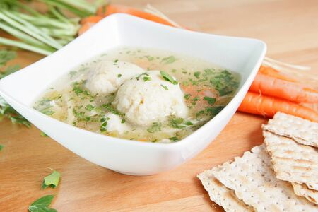 Matzah Ball Soup with carrots and Matzo bread Stock Photo - 17239562