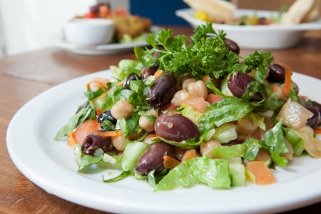 entree: Entree, full sized hearty Greek style salad Stock Photo