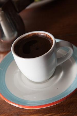 dramatically: dramatically lit turkish coffee with metal carafe