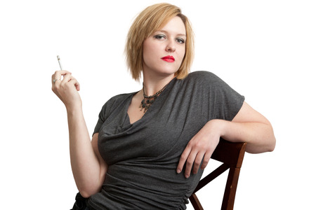 Sultry Redhead Woman with Cigarette Stock Photo