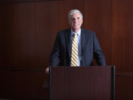 Executive Senior Professional Man At Poduium