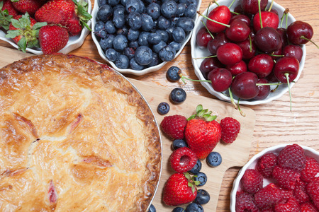 homestyle pie surrounded by fresh fruit