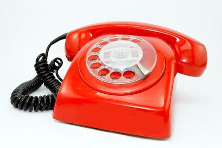 Red telephone isolated on white background photo