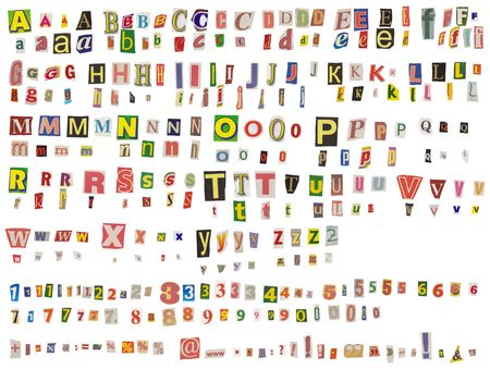 Alphabet newspaper uppercase, lowercase, numbers and symbols cutouts isolated on white. Mix and match to make your own words photo