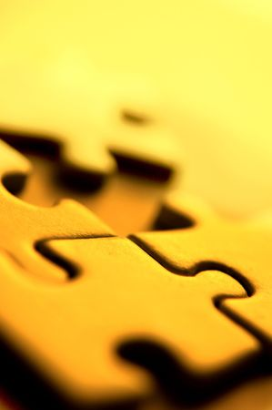 Close up shot of four puzzle pieces. Stock Photo