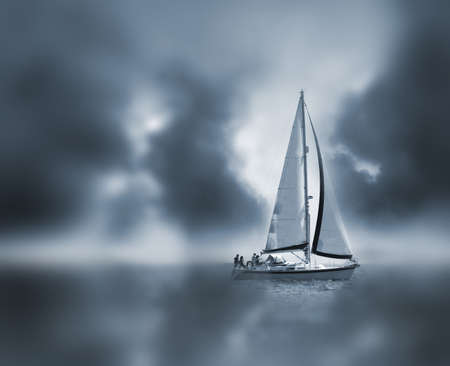 A sail boat in fog and clouds. Stock Photo - 980121