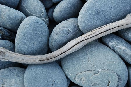 beachcomb: Pebbles and Driftwood Stock Photo