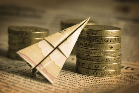 Financial Concept with a paper plane and coins. Stock Photo - 2397906