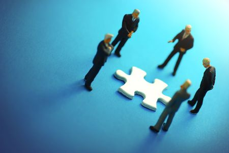 A business team around a puzzle piece. photo