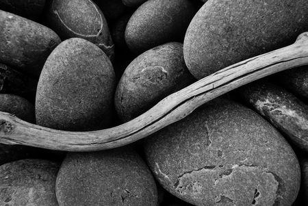 beachcomb: Pebbles and Driftwood Stock Photo