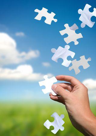 piezas de rompecabezas: Una mano a la captura de caer piezas del rompecabezas. Resoluci�n de problemas concepto. Ver mi galer�a de m�s.