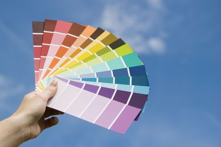 guides: A women holding some colour guides. Stock Photo