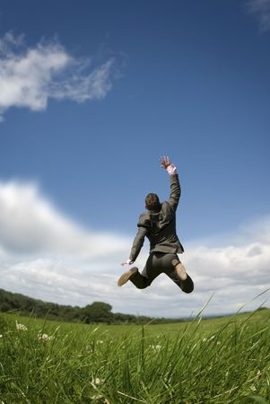A businessman reaching for the sky! Stock Photo